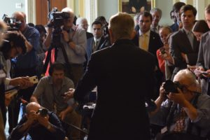 Senator Harry Reid speaks to the press